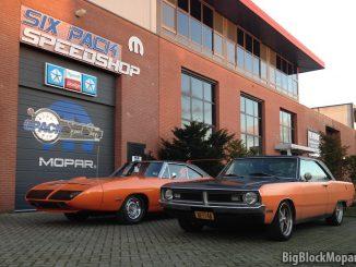 1973 Dodge Dart next to 1970 Plymouth Superbird at SixPack Speedshop