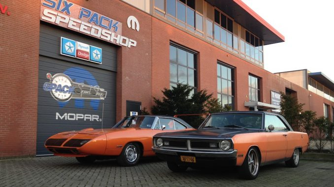 1973 Dodge Dart next to 1970 Plymouth Superbird at SixPack Speedshop