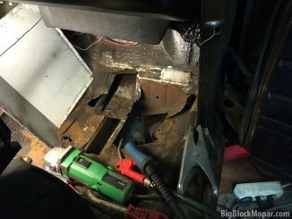 Picking and grinding away the floorboard and most of the rust and holes.